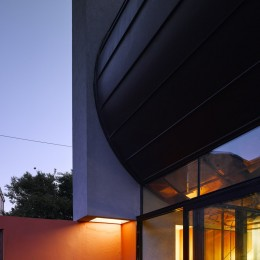 Exterior view of courtyard at dusk showing interior lights