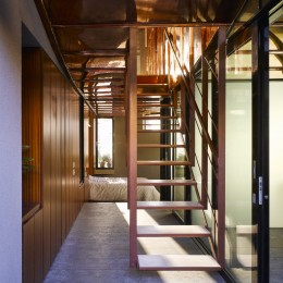 Interior view of corridor showing bedroom and stairs