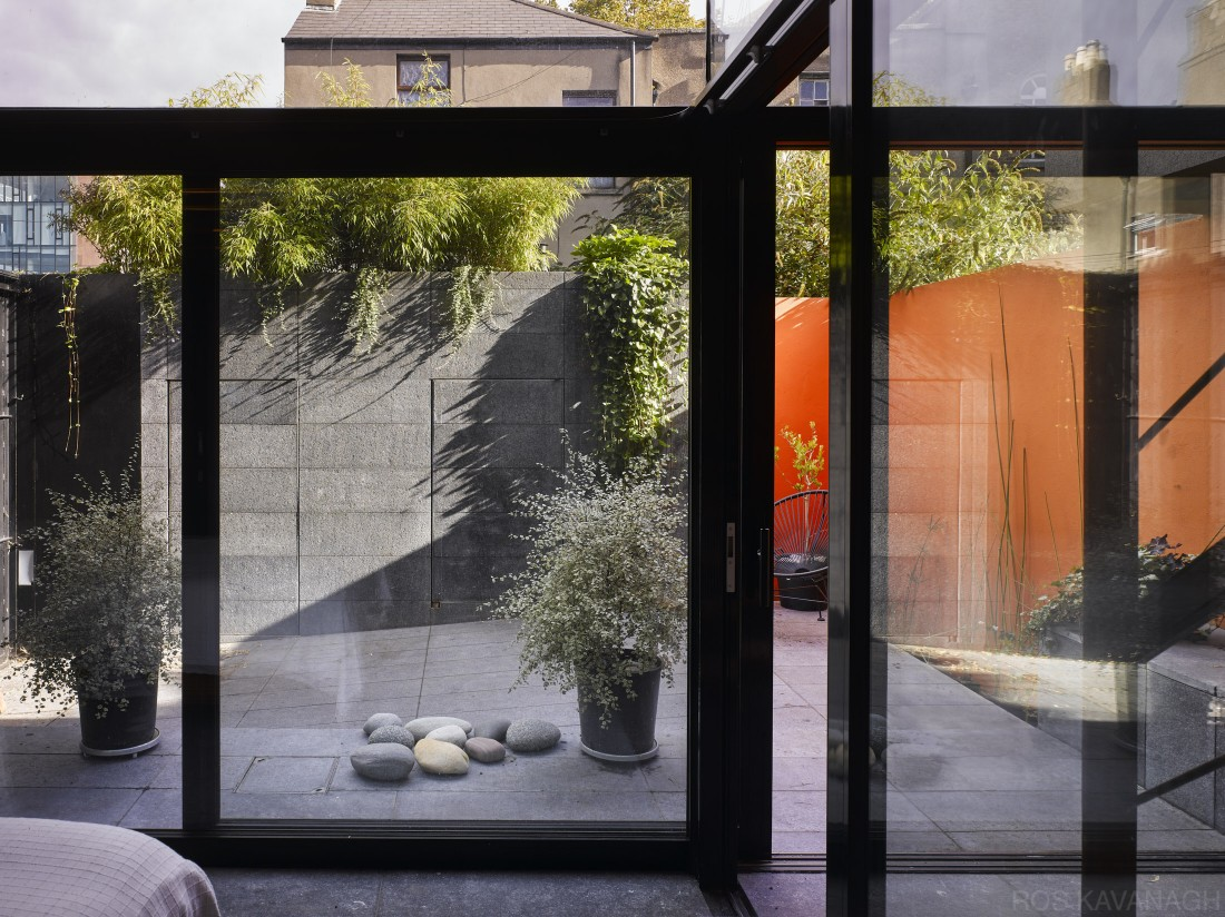 Interior view of living area showing glass doors to courtyard