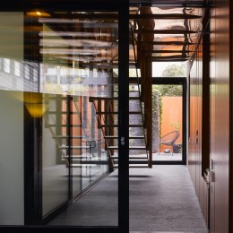 Interior view of corridor showing stairs and glass doors