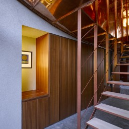 interior view of corridor showing timber panelling and stairs