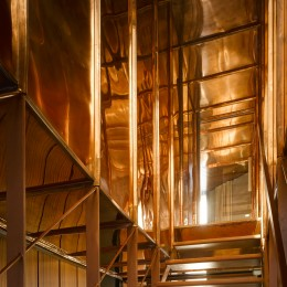 Interior view of copper staircase showing enclosure
