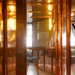 Interior view of copper panelling showing chair