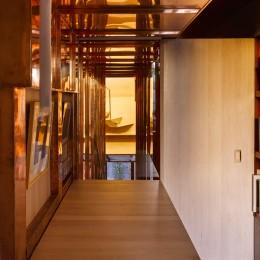 Interior view of adjustable counter showing copper stairway and open door