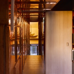 Interior view of corridor showing copper stairway and door