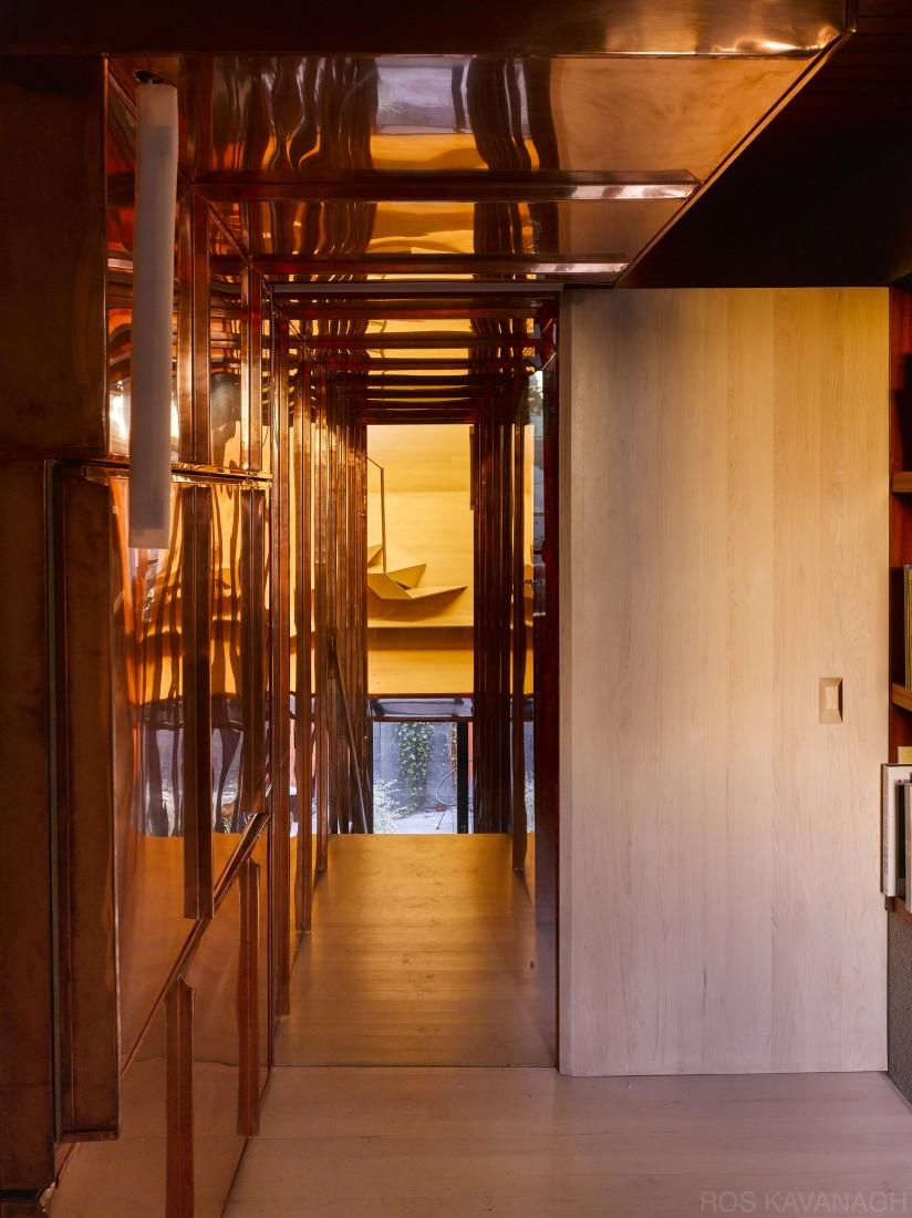 Interior view of corridor showing copper stairway and door
