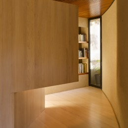 Interior view of living space showing curved wall with wall panel open