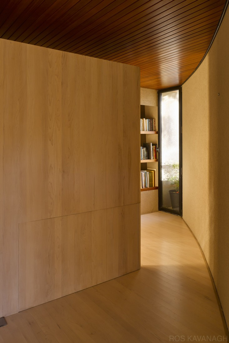 Interior view of living space showing curved wall with wall panel closed