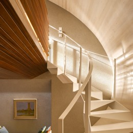 Interior view of steel stairway showing curved timber panelling and seating area
