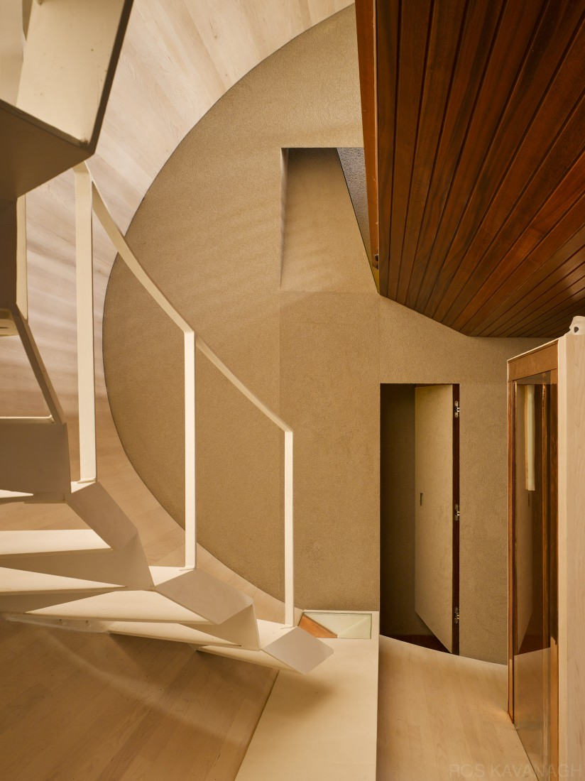 Interior view of corridor showing stairs and open doorway
