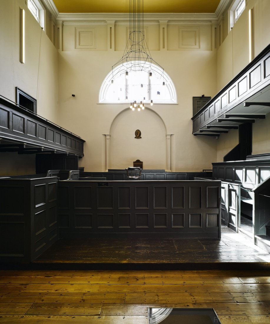 Interior view of court room showing benches and timber floor