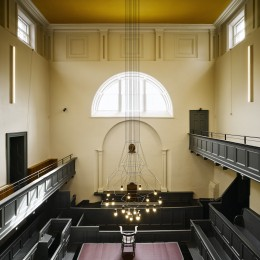 Overhead view of court room showing benches and chandelier