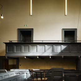 Interior view of court room showing benches and lighting