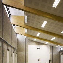 View of gymnasium showing timber beams and school children