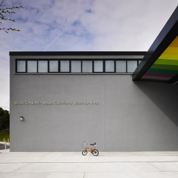 View of school entrance showing coloured soffit panels and bicycle