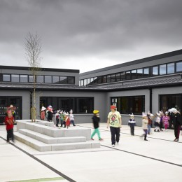 Wide view of courtyard showing school children
