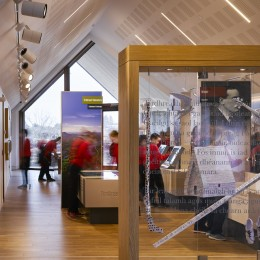 Interior view of exhibition space showing install and school group