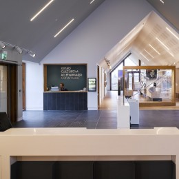 Interior view of reception area showing view through to exhibition area
