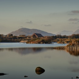 Exterior view of centre across Lough Aroolagh showing the Twelve Pins Mountains