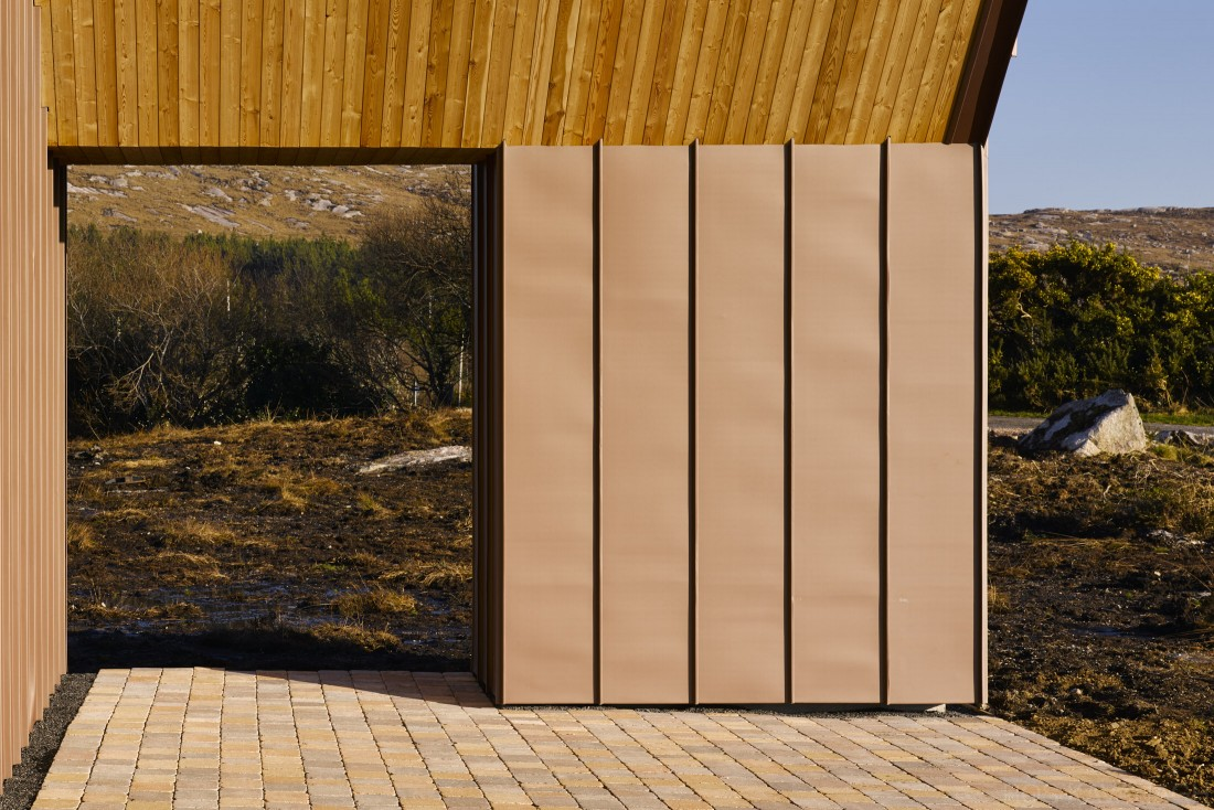 Exerior view of patio showing copper cladding and bogside