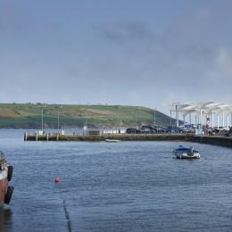 VIew of umbrellas along quayside